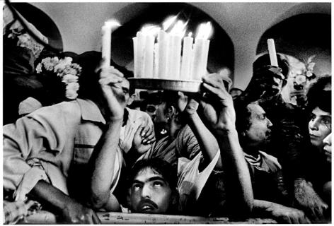 Ernesto Bazan, Cuba, Sous Les Etoiles Gallery,Santiago de las Vegas, Saint Lazarus, devotee, candles, cuban ceremony, crowd