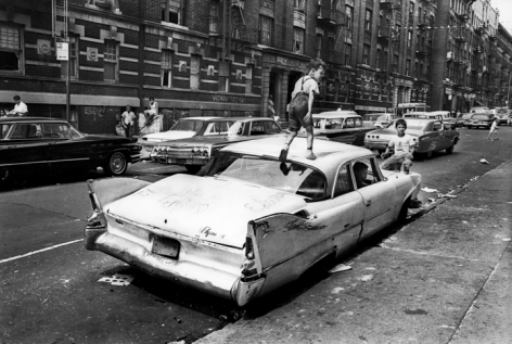 Jean-Pierre Laffont, Black Ghetto, kid walking on car, Bronx, 1966 Turbulent America, Sous Les Etoiles Gallery