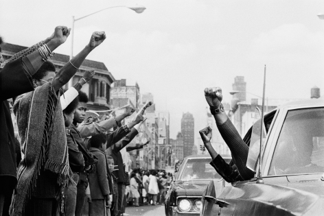 Jean-Pierre Laffont, Attica Funerals people holding the Black Panther Salute, Turbulent America, Sous Les Etoiles Gallery