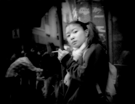 James Whitlow Delano, Mangaland, Pony tails, piercing glance and a cigarette, Shibuya, Tokyo, Japan, 1998, Sous Les Etoiles Gallery