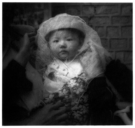 James Whitlow Delano, Empire, Impressions from China, Veiled infant, Gansu Province, China, 1994, Sous Les Etoiles Gallery