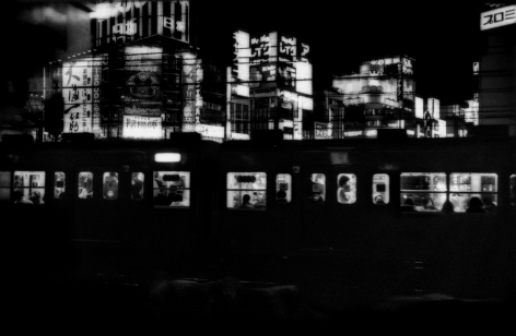 James Whitlow Delano, Mangaland, Chuo Line train coming into Shinjuko Station, Tokyo, Japan, 2005, Sous Les Etoiles Gallery