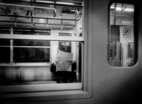 James Whitlow Delano, Mangaland, Absorbed in a newspaper, commuter train near Tokyo, Japan, 2009, Sous Les Etoiles Gallery