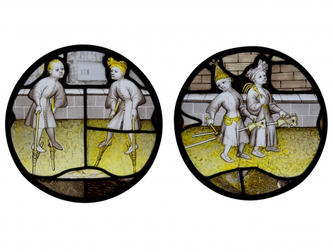 Two stained-glass roundels depicting children's games, c. 1450