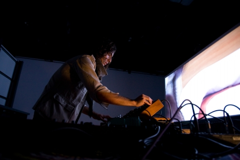 """Doug Aitken, Sonic Happening, a live music performance set  to the film installation of """"migration (empire)"""" featuring Arp, Lichens and White Rainbow, 303 Gallery, 2008"""