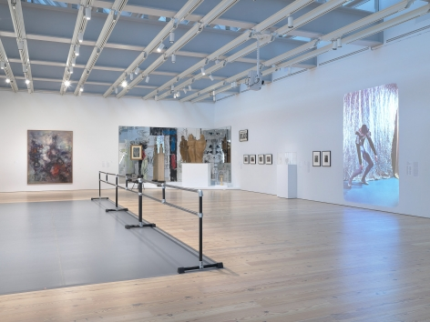 Installation view of Nick Mauss: Transmissions, Whitney Museum of American Art, New York, 3/16 - 5/14/2018, Left to right:  Dorthea Tanning, Aux environs de Paris (Paris and Vicinity), 1962; Nick Mauss, Images in Mind, 2018; Documentation of George Balachine chorerography in rehearsals, 1951-58; Pavel Tchelitchew, Interior Landscape Skull, 1949; John Storrs, Forms in Space #1, c. 1924; Elie Nadelman, Two Circus Women, c. 1928-29; Gustav Natorp figure (formerly owned by Lincoln Kirstein), 1898; Sturtevant, Relâche, 1967; Ilse Bing, Untitled (Skyscrapers, night, NY), 1936; Ilse Bing, Dead End II, 1936.; Ilse Bing, Three Birds in the Sky, Paris, 1936; Ilse Bing, Between France and U.S.A. (Seascapes), 1936; Elie Nadleman, Untitled, c. 1938-46; Elie Nadelman, Untitled, c. 1938-46; Elie Nadelman, Untitled, c. 1938-46; Elie Nadelman, Untitled, c. 1938-46; Carl Van Vechten, Al Bledger of the Von Grona (American) Negro Ballet, 1938; Carl Van Vechten, Al Bledger of the Von Grona (American) Negro Ballet, 1938; Carl Van Vechten, Carl Van Vechten slideshow, 1940-64. Photograph by Ron Amstutz. Digital image © Whitney Museum of American Art, New York