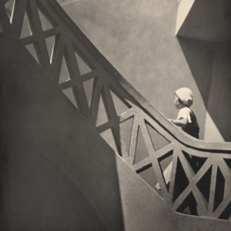 Hisao E. Kimura Woman climign stairs to roof garden