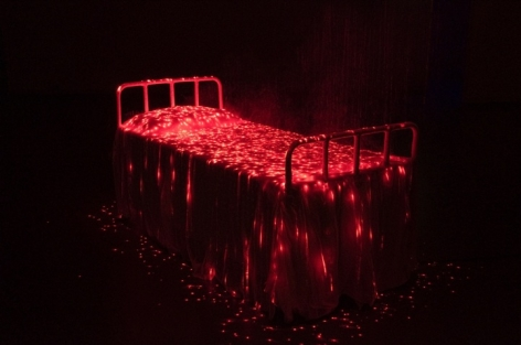 My Modern Met | Bright Red Lights Illuminate a Bed Covered in Eerie Mist