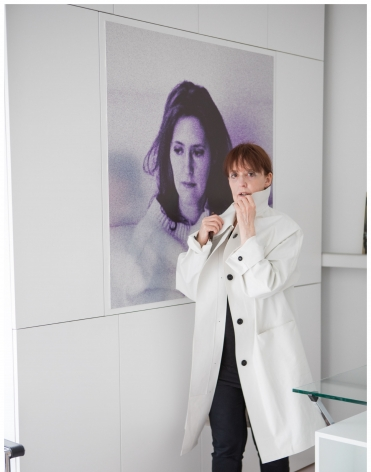 WM in white raincoat