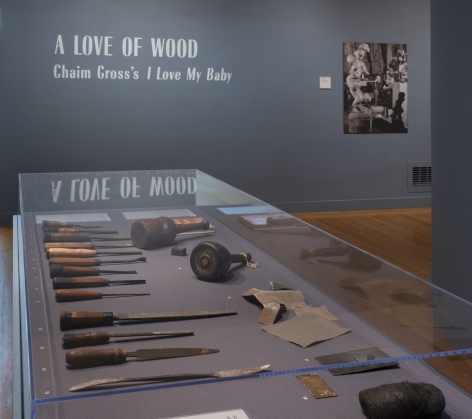 Close up image of the encased wooden sculpture tools and equipment featured in the exhibit.