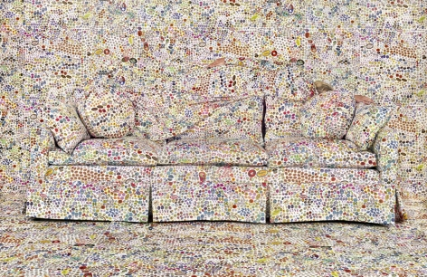 Rachel Perry,Lost in My Life (Fruit Stickers Reclining Behind Sofa),2019. Archival pigment print, 40 x 60 inches.