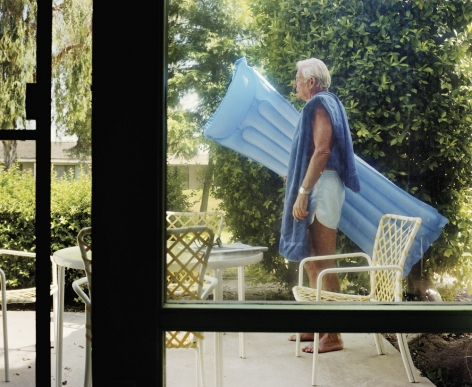 Dad with Raft, from the series Pictures from Home, 1987, 40 x 50 inch archival pigment print please inquire for additional sizes