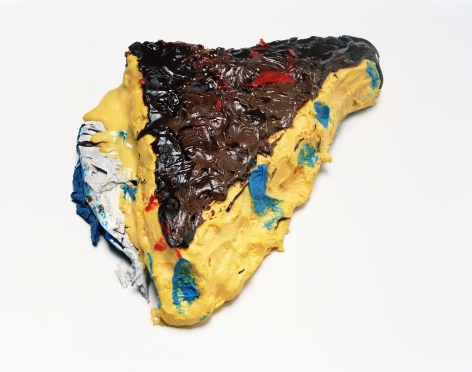 Photograph by Sharon Core. Custard pie with frosting and blue icing arranged to look like the sculpture by Claes Oldenburg