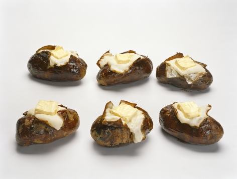 Six baked potatoes with butter based on the sculpture by Claes Oldenburg and then presented as a photograph