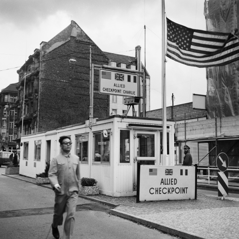 Checkpoint Charlie, (running) Berlin, Germany, 1986. Gelatin silver print, 16 x 16 inches.
