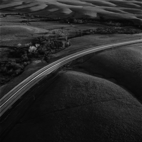 Interstate 35 intersecting the Flint Hills, Kansas, April, 1994. Vintage gelatin silver print, image size 15 x 14 7/8 inches.