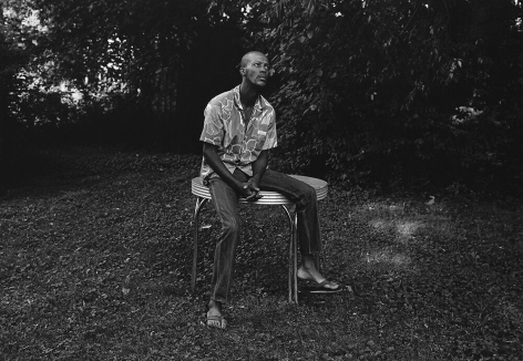 Mark Steinmetz, Knoxville, TN (man sitting on table), 1991. Gelatin silver print, 20 x 24 inches.