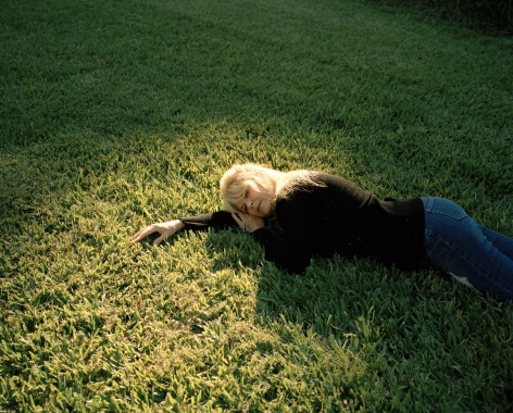 Kaitlin Maxwell,Grandma Candy Lying in the Grass, Florida,2019. Archival pigment print, 24 x 30 inches.