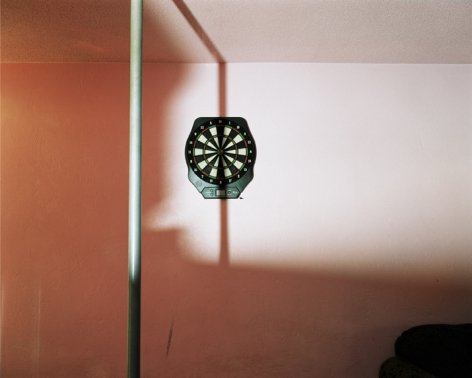 Dartboard and stripper pole at swinger's club, Daytona Beach, Florida, 2005. Archival Pigment Print, Editions of 5. Available Sizes: 24 x 20 inches, 40 x 30 inches, and 50 x 40 inches
