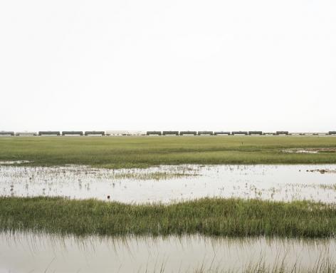 Untitled (Trains Crossing Estuarial Corridor-4), Virginia Point, Texas, 2015.