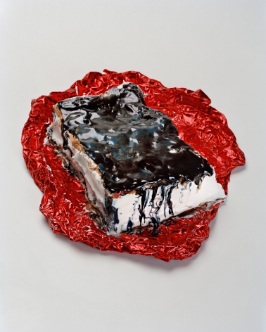 Photograph by Sharon Core. An ice cream sandwich and red foil wrapper arranged to look like the sculpture by Claes Oldenburg.