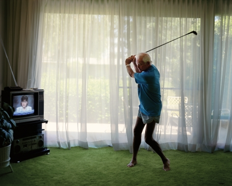 Practicing Golf Swing, from the series Pictures from Home, 1986, 40 x 50 inch archival pigment print please inquire for additional sizes