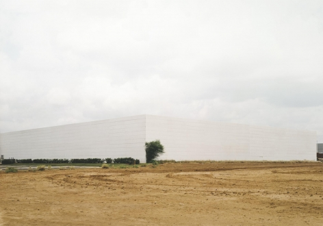Untitled, White building with bush, Laredo, Texas, 2003, 39 x 55 inch or 55 x 75 inch chromogenic print