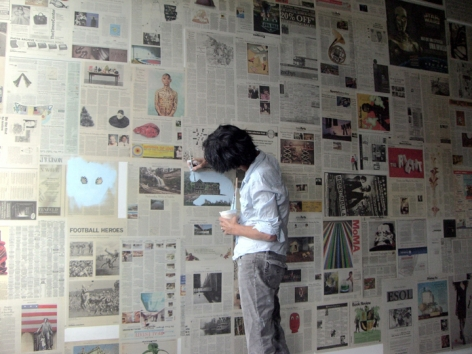 Anne Deleporte working on a wall painting