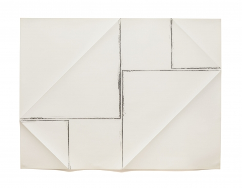 a piece of white paper which has been folded and rubbed with charcoal to show the folds