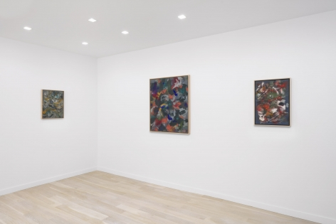 installation view of three abstract paintings