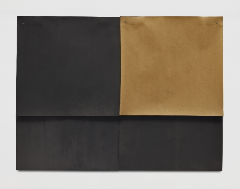 two sheets of black paper with one rectangular cheet of brown paper in the upper right