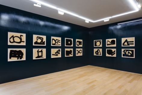 installation view of india ink drawings in a blue room