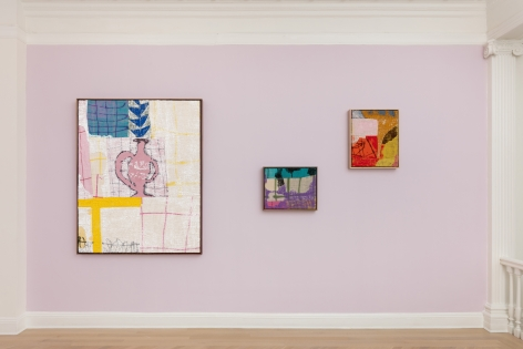 installation view of abstract paintings in multiple colors on burlap