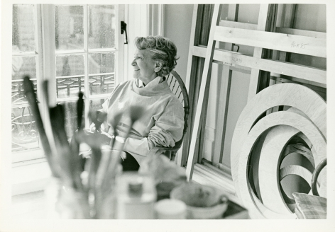 woman sitting in her studio
