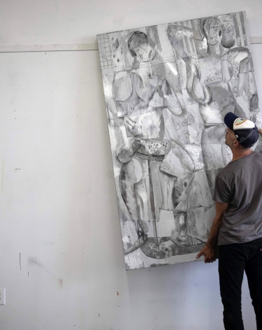 image of a man moving a silver painting