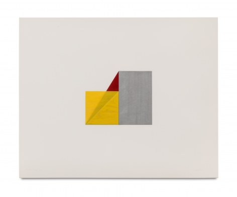 multicolored folded pieces of paper on a white ground