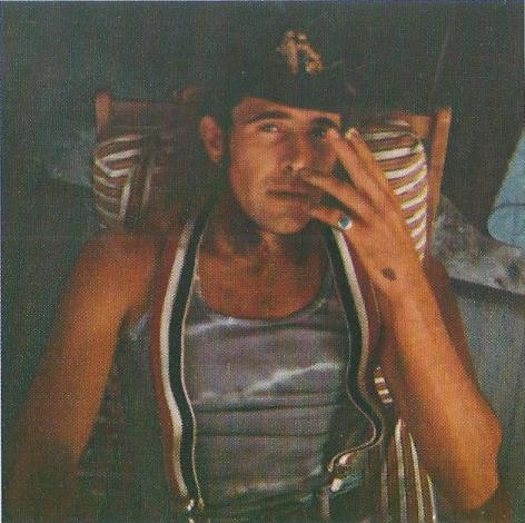 image of a man smoking in suspsenders