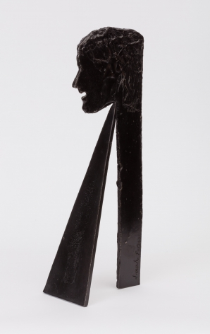 statuette of a woman's face with a large triangular base