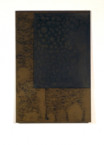 pieces of chipboard coated in crude oil