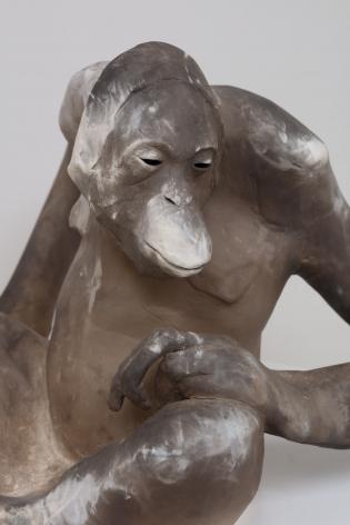 ceramic tan colored Orangutan