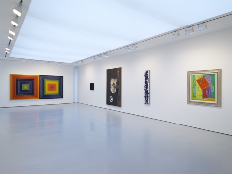 installation view of multiple paintings in a large gallery