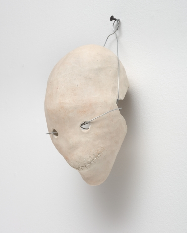 ceramic skull with a wire through the eyes
