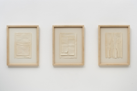 three framed works that are sheets of paper torn in various ways