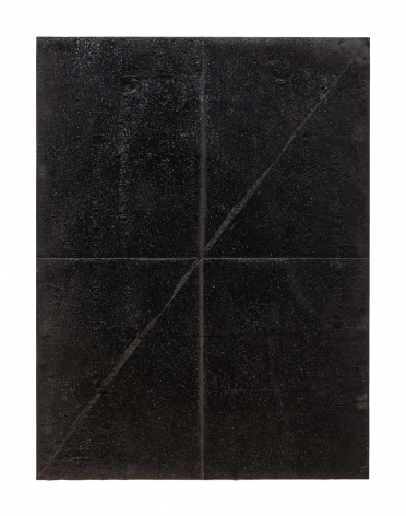 a piece of paper coved in tar then folded