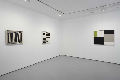 installation view of geometric abstract paintings