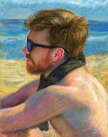 a man sitting on the beach in sunglasses
