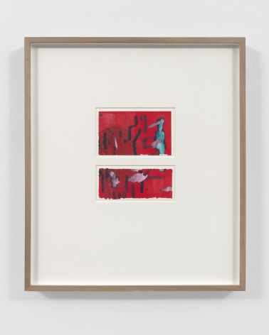 two small red abstract drawings in a wood frame