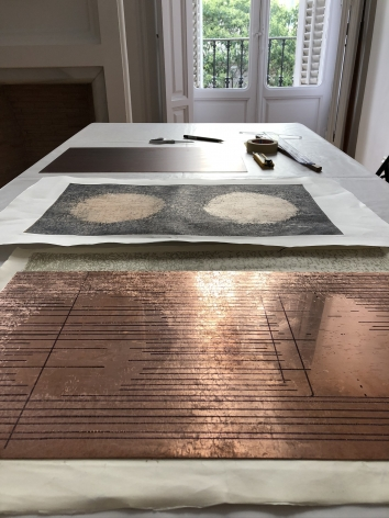 table with a printmaking plate
