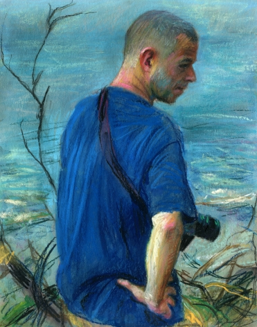 a drawing of a man with a camera standing at the ocean edge