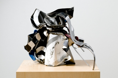 a sculpture made with spikey steel